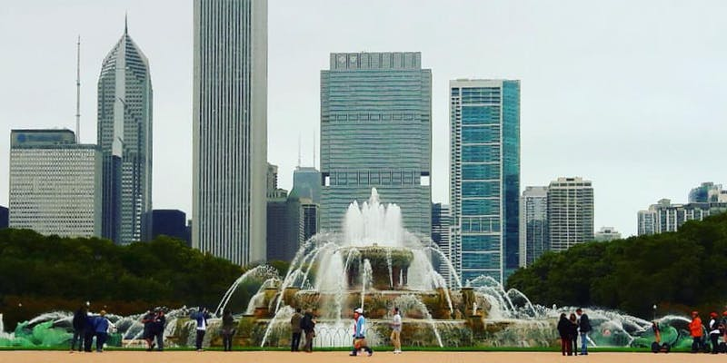 Image is of Chicago's Buckingham Fountain spouting water against a backdrop of the Chicago skyline on a summer day. Photo credit Adam Ballard.